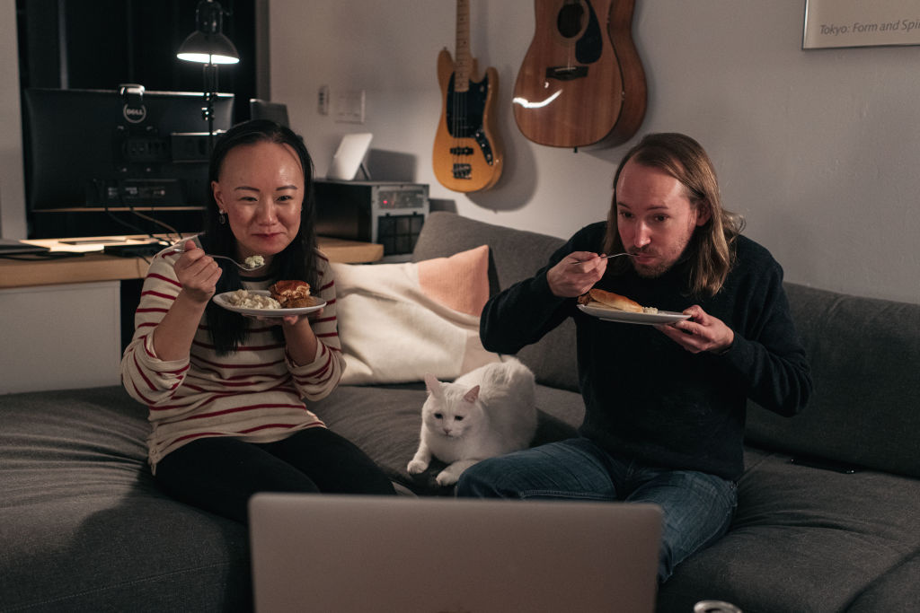 A couple celebrates Thanksgiving with friends by having dinner together over a Zoom video call on November 22, 2020 in New York City.