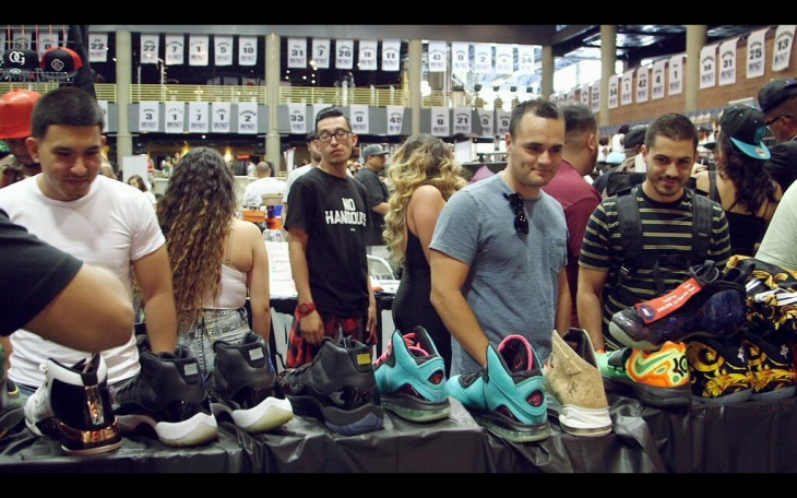 Sneakerheads size up the wares at a shoe convention. From the documentary