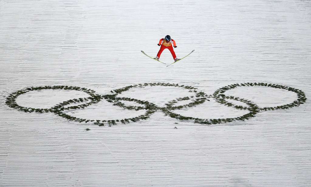 SOCHI, RUSSIA - FEBRUARY 17: Dimitry Vassiliev of Russia jumps during the Men's Team Ski Jumping first round on day 10 of the Sochi 2014 Winter Olympics at the RusSki Gorki Ski Jumping Center on February 17, 2014 in Sochi, Russia.  (Photo by Paul Gilham/Getty Images)