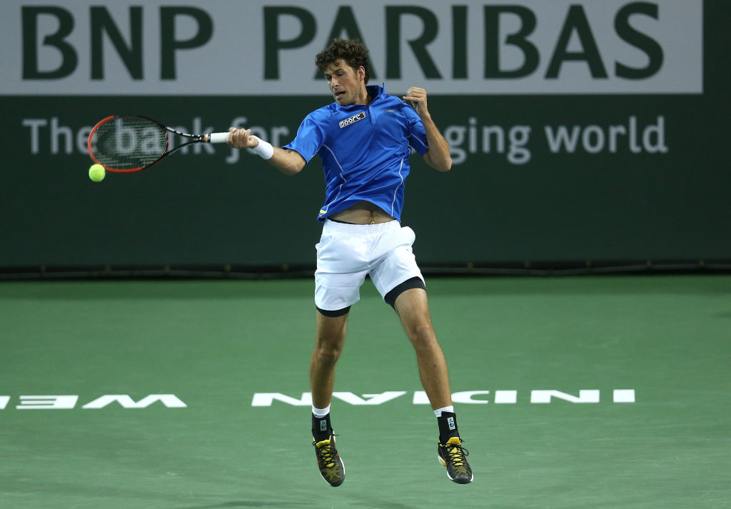 Robin Haase of the Netherlands hits a return to Grigor Dimitrov of Bulgaria during the BNP Paribas Open at Indian Wells Tennis Garden on March 9, 2014 in Indian Wells, California.