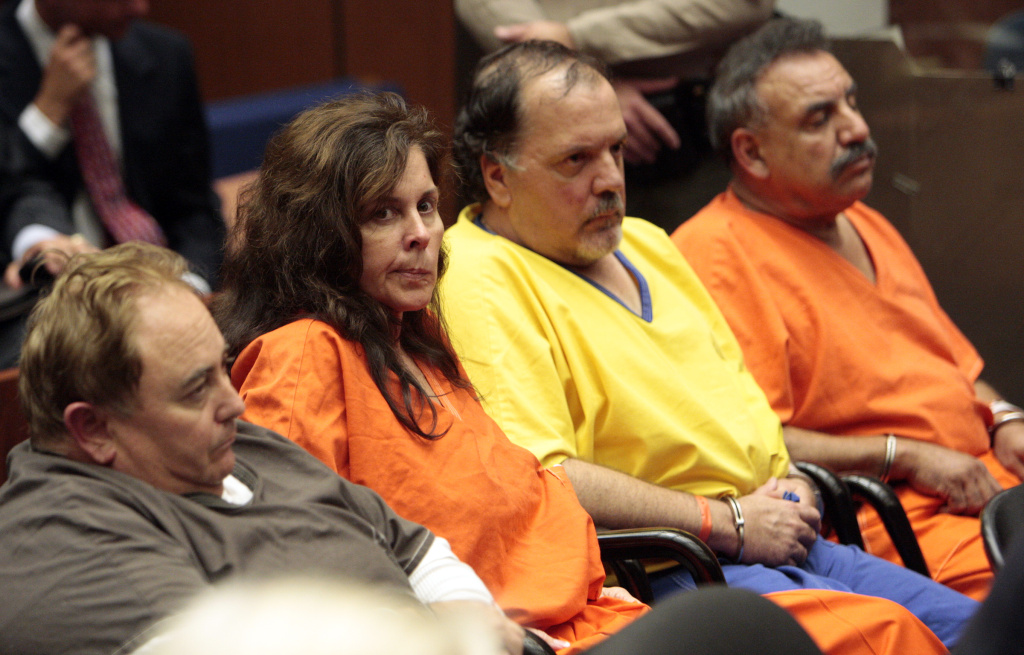 Former and current Bell city employees, Robert Rizzo (L), former city manager, Angela Spaccia (2L), former assistant city manager, Victor Bello (3L), former council member, and Oscar Hernandez (R), mayor, attend a bail reduction hearing on September 22, 2010 in Los Angeles.