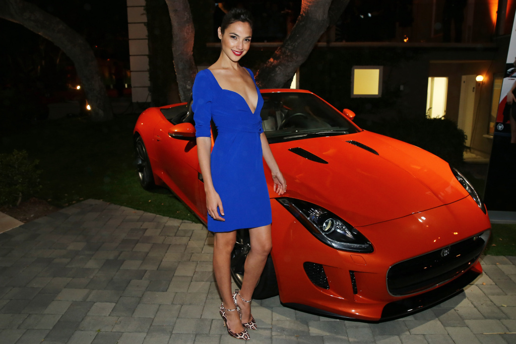 Actress Gal Gadot with the 2014 Jaguar F-TYPE at the Jaguar and Playboy Magazine exclusive VIP reception to celebrate Jaguar's high-performance models during Pebble Beach weekend on Aug. 16, 2013 in Monterey.