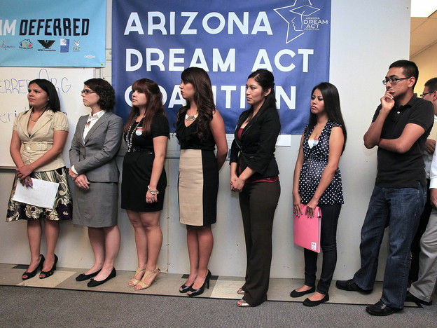 Advocacy group representatives and young immigrants line up in Phoenix, Arizona for guidance about the federal deferred action program in August 2012, when the program began. On Thursday, Homeland Security officials announced renewal rules for recipients; the temporary legal status obtained by the first recipients two years ago is set to expire in September.