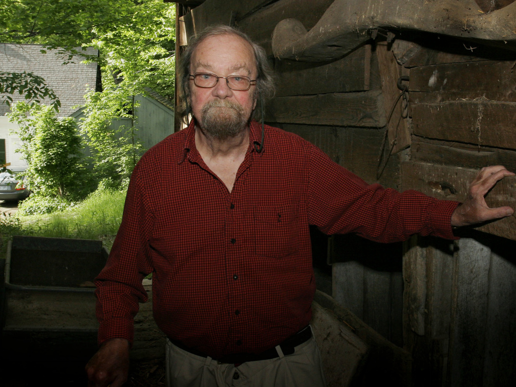 Donald Hall, former poet laureate of the United States, author of numerous poetry books, poses on June 13, 2006, in the barn of the 200-year-old Wilmot farm that has been in his family for four generations. Hall died on Saturday at age 89.