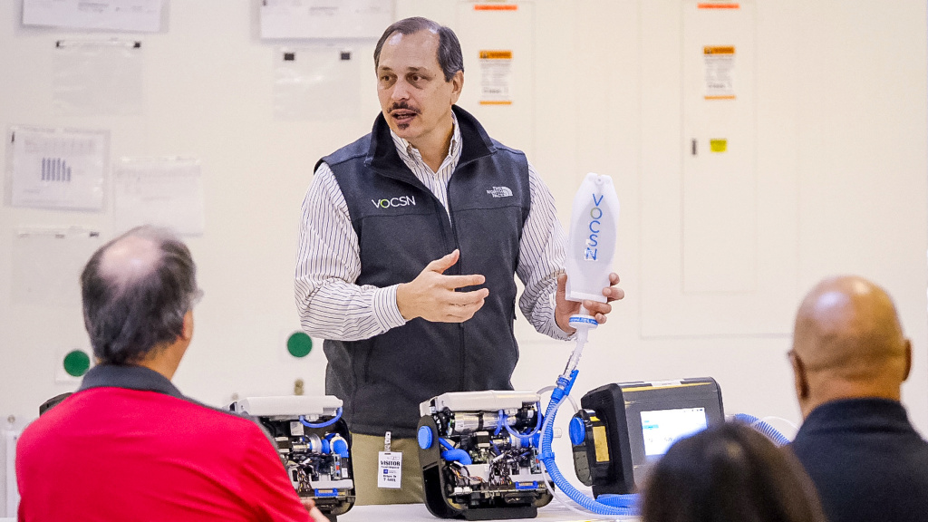 Joe Cipollone of Ventec Life Systems explains the company's critical care ventilator to General Motors employees who will be helping to produce the ventilators at a GM plant in Kokomo, Ind., on Friday.