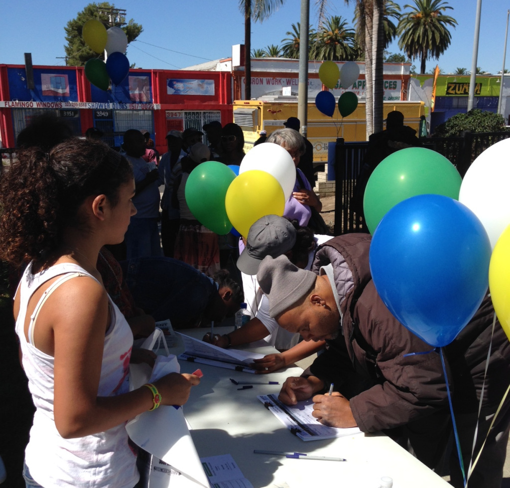 South LA residents sign in to attend the South LA Power Festival, an event organized around providing information on health care coverage.