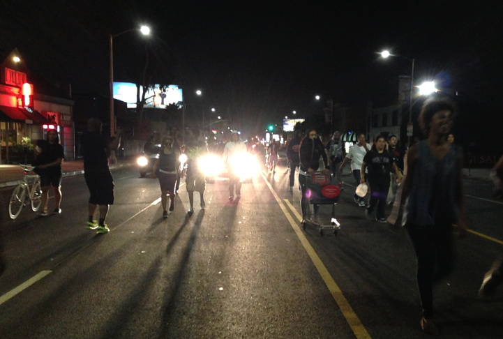 About 120 people walked straight up LaBrea Saturday night to protest the acquittal of George Zimmerman in the shooting death of Trayvon Martin. Helicopters circled above as the crowd stopped at LaBrea-Santa Monica for about 10 minutes before continuing on,