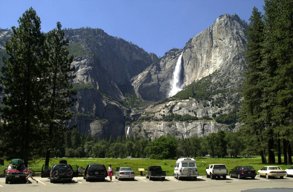 Cars fill a parking lot near Yosemite Falls (background), June 18, 2000 in Yosemite National Park, California.