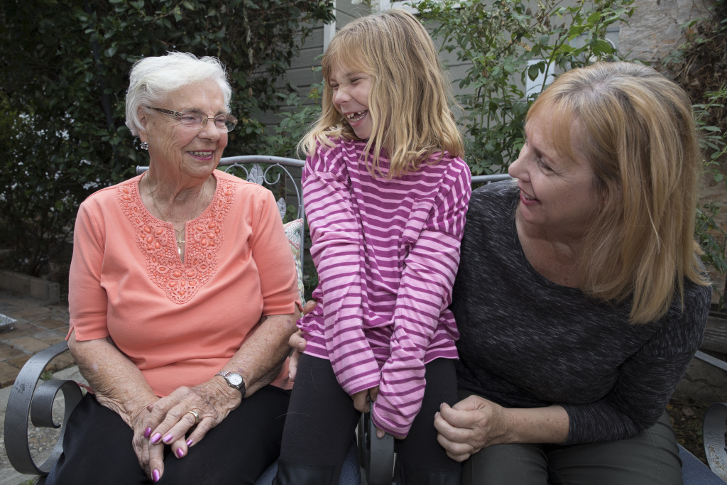Lisa Patterson's mother Helene Marhefka, left, Lisa's daughter Brooke Patterson and Lisa's oldest sister Roberta Marhefka spend time at the Paterson home in Lomita, California, on Oct. 30, 2017. Lisa Patterson was killed during the Oct. 1 shooting attack in Las Vegas.
