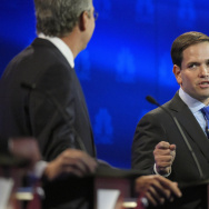 Marco Rubio, right, and Jeb Bush, argue a point during the CNBC Republican presidential debate at the University of Colorado, on Wednesday in Boulder, Colo.