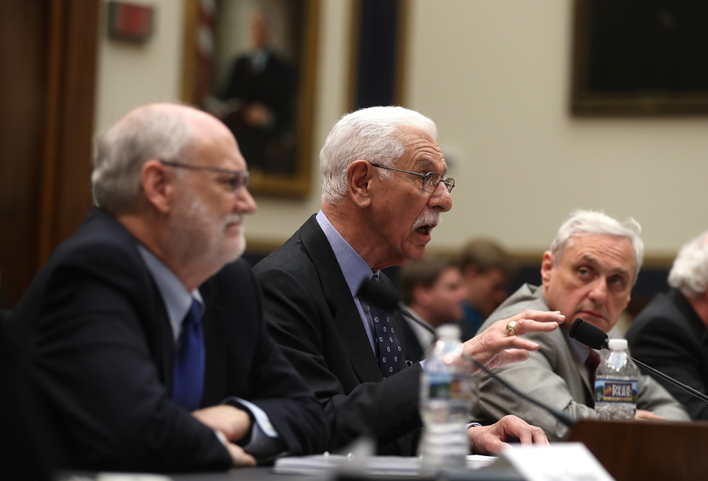 File: Ninth Circuit Appeals Court Judge Carlos Bea (C) speaks as fellow Judges Sidney Thomas (L) and Alex Kozinski (R) look on during a House Judiciary Committee hearing on March 16, 2017 in Washington, DC. Judges with the Ninth testified before the committee about the restructuring of that court.