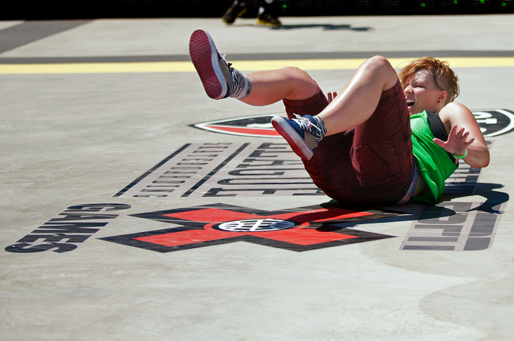 Chandler Dunn of Temecula does a flip on a Razor during the first day of X Games Los Angeles outside STAPLES Center and L.A. Live.