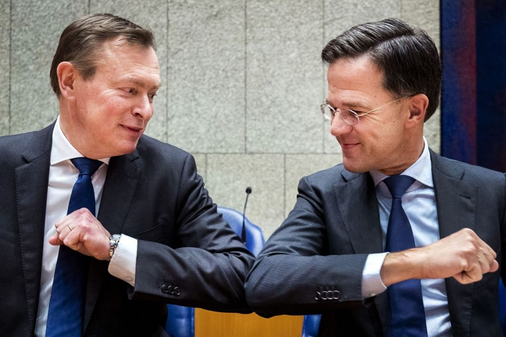 Dutch Prime Minister Mark Rutte (R) gives Dutch Minister for Medical Care Bruno Bruins an elbow greeting in order to prevent the spread of the novel coronavirus during the weekly Question Time in the Lower House in The Hague, The Netherlands on March 10, 2020.