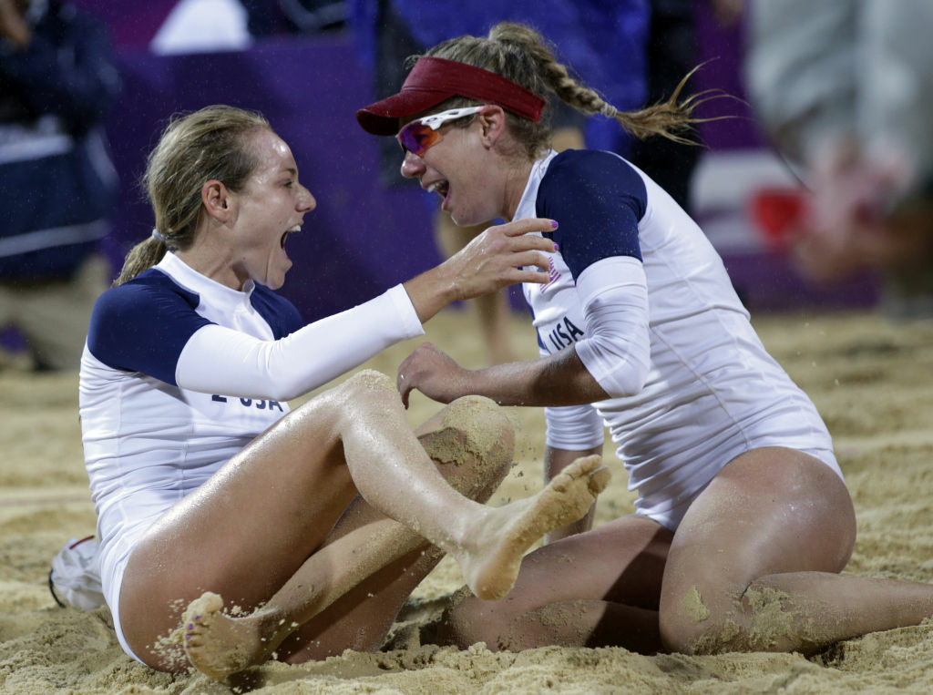 The United States Jennifer Kessy, left, and April Ross celebrate after beating top seeded Brazil during a women's semifinal beach volleyball match at the 2012 Summer Olympics, Tuesday, Aug. 7, 2012, in London. (AP Photo/Dave Martin)