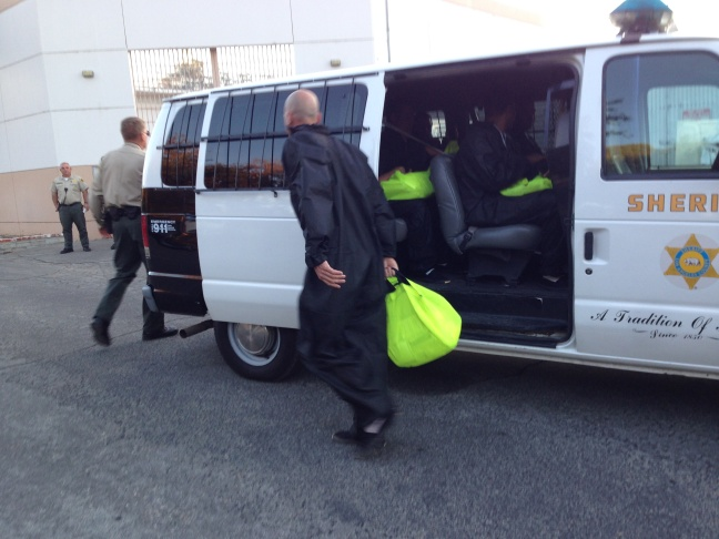 Hendrick Robler gets ready to board a van at the Pitchess Detention Center in Castaic that is headed to a firefighting camp in Sylmar.