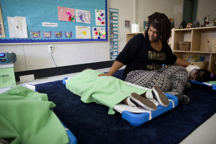 Tawnya Spencer rubs the backs of children during nap time at a Head Start program in Imperial Gardens in Watts. The program is run by Children's Institute, which serves more than 22,000 children in Los Angeles' most challenging neighborhoods.