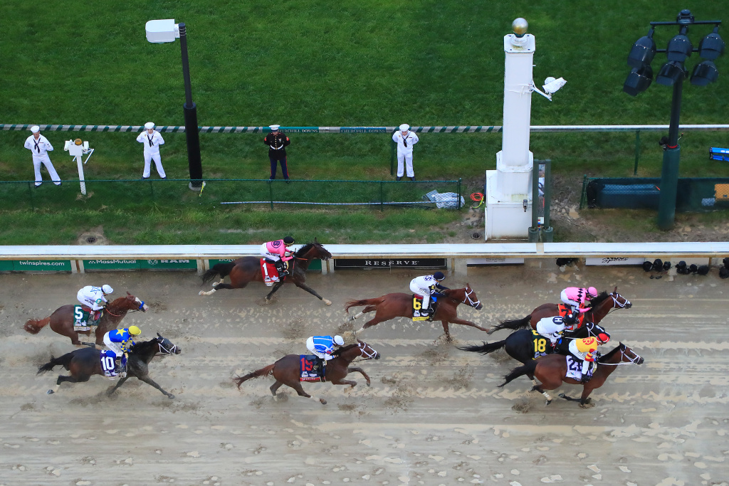The field heads to the first turn during the 145th running of the Kentucky Derby at Churchill Downs on May 04, 2019 in Louisville, Kentucky.