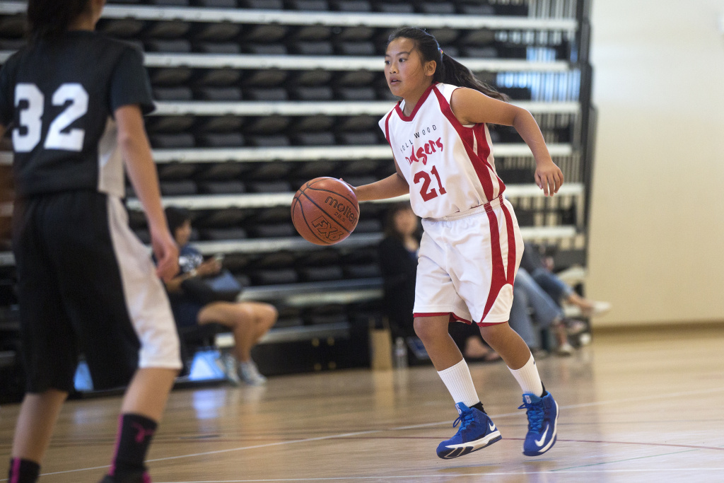 Hollywood Dodgers shooting star Maile Nakaji plays point guard during the first of three games at the West Los Angeles Youth Club's Invitational Basketball Tournament at Rancho Dominguez Preparatory School in Long Beach on Saturday morning, April 16, 2016.