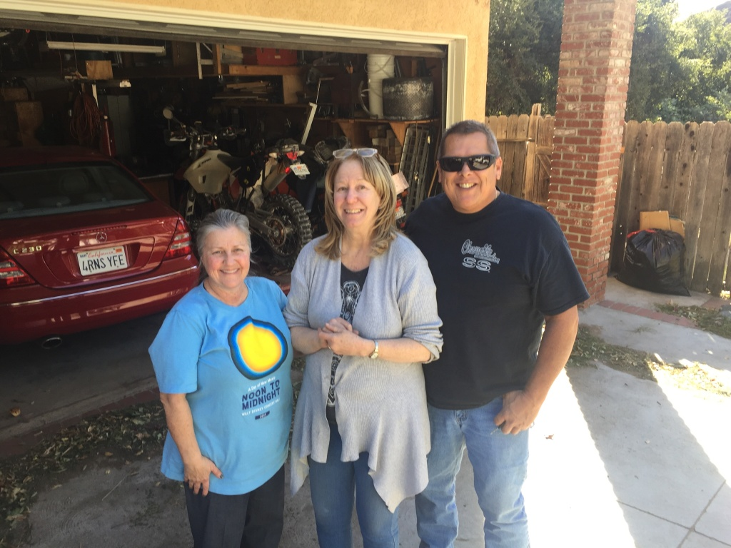 Carol Van Dusen (center) evacuated for the Creek Fire on Tuesday morning. She shared a moment of relief with her Kagel Canyon neighbors after returning to their homes on Friday.