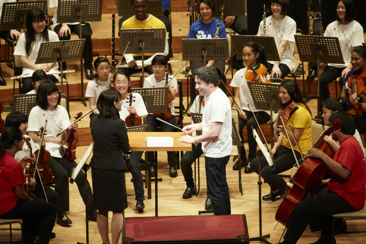 LA Philharmonic's music and artistic director Gustavo Dudamel conducts a rehearsal at Tokyo's Suntory Hall with an orchestra comprised of children from Youth Orchestra L.A. (YOLA) and from the El Sistema orchestra in Soma, Japan.
