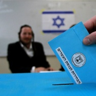 An Israeli ultra-orthodox Jewish man casts his ballot at a polling station in Bnei Brak, near the city of Tel Aviv, on March 17, 2015. Israelis are voting in a close-fought election pitting the centre left against Prime Minister Benjamin Netanyahu, who ruled out a Palestinian state in a last-ditch appeal to the far-right.