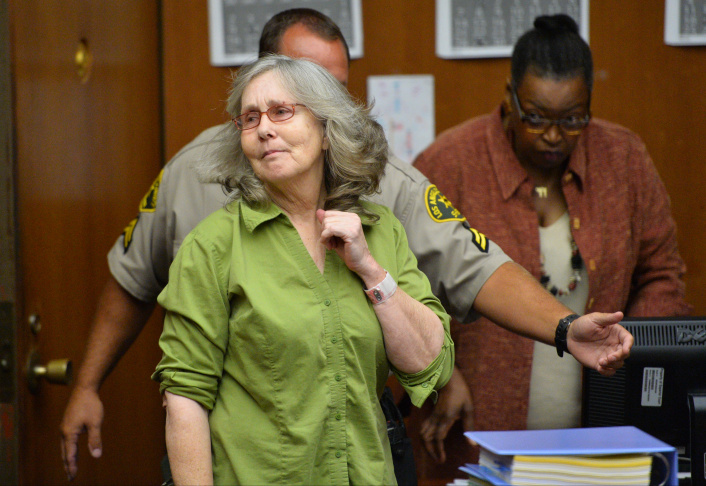 Susan Mellen looks at the judge as she enters the courtroom for her exoneration proceedings on Friday, Oct. 10, 2014 in Torrance.