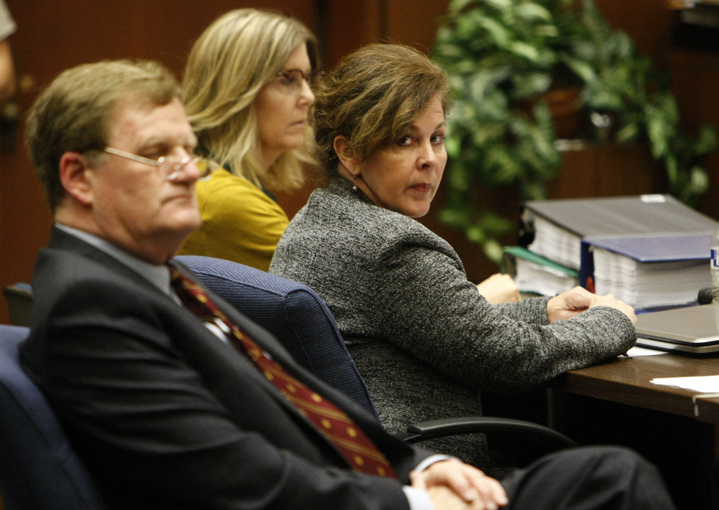 Former assistant city manager of Bell, Angela Spaccia, center, is charged with misappropriation of public funds and other counts. On Wednesday, the city's former police chief testified in her trial.