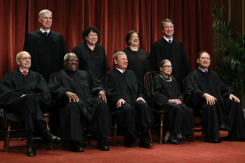 United States Supreme Court (Front L-R) Associate Justice Stephen Breyer, Associate Justice Clarence Thomas, Chief Justice John Roberts, Associate Justice Ruth Bader Ginsburg, Associate Justice Samuel Alito, Jr., (Back L-R) Associate Justice Neil Gorsuch, Associate Justice Sonia Sotomayor, Associate Justice Elena Kagan and Associate Justice Brett Kavanaugh pose for their official portrait at the Supreme Court building.