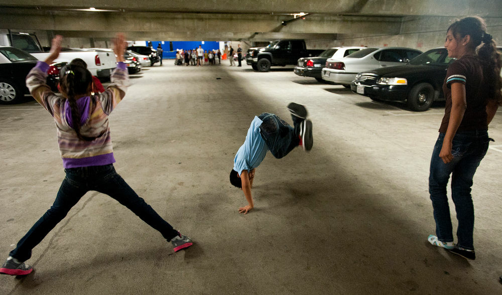 Kids do cartwheels after running during an exercise drill. The Newton Street Police Activities League also offers martial arts, boxing, yoga, and gardening, among many other activities for kids in the community.