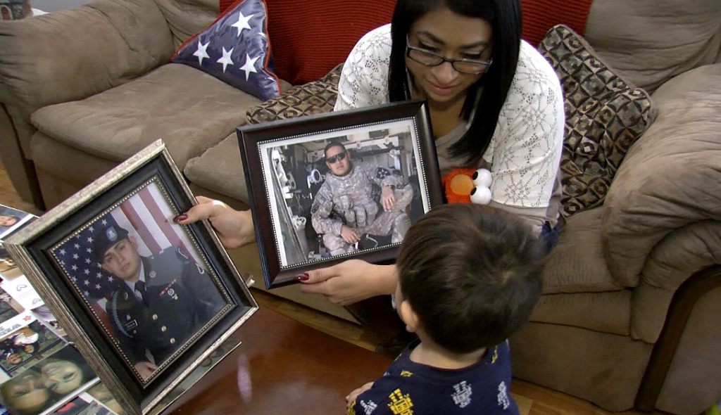 Widowed while pregnant with their second son, Gloria Grijalva shares pictures of her husband, U.S. Army veteran Charlie Grijalva, who committed suicide in December 2014.