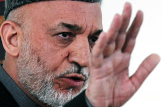 Afghan President Hamid Karzai at the Independent Electoral Commission compound in Kabul on April 1, 2010.