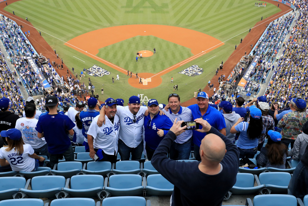 Fans take a photograph before game seven of the 2017 World Series between the Houston Astros and the Los Angeles Dodgers at Dodger Stadium on Nov. 1, 2017.