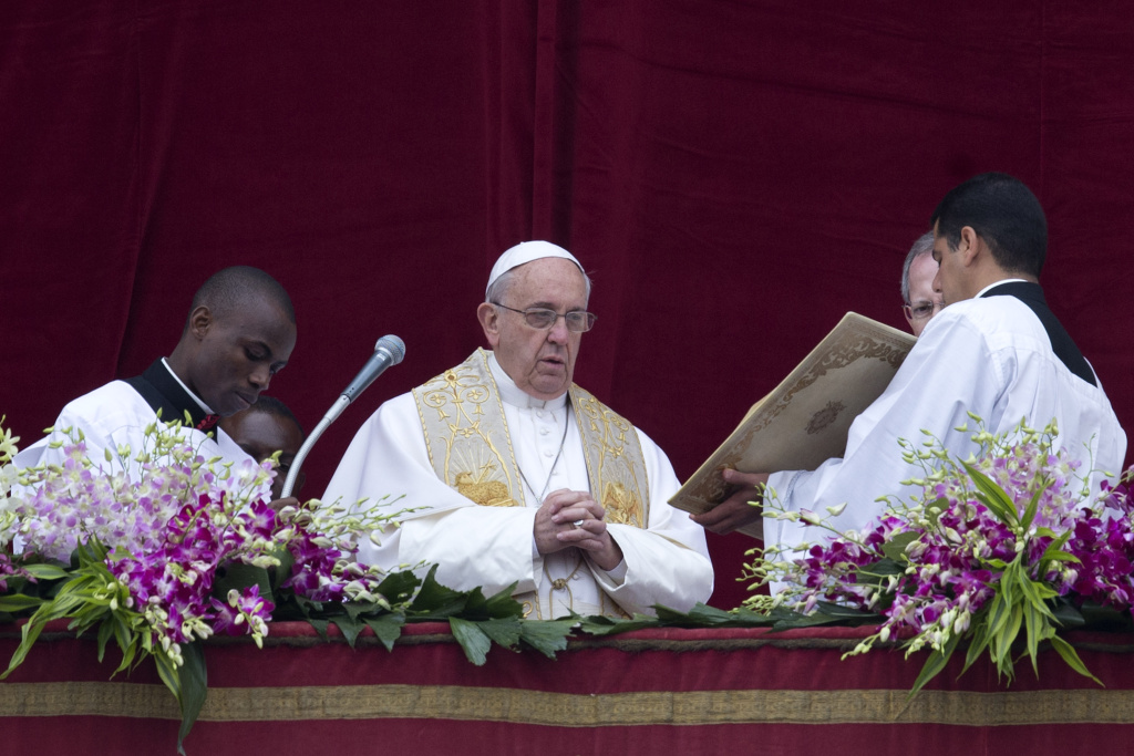 Pope Francis speaks before delivering the Urbi et Orbi (to the city and to the world) blessing at the end of the Easter Sunday Mass in St. Peter's Square at the Vatican, Sunday, April 5, 2015. (AP Photo/Andrew Medichini)