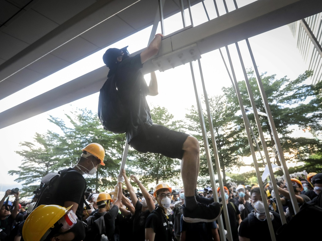 Protesters dismantled part of the metal facade at the government's headquarters in Hong Kong on July 1 — the 22nd anniversary of the city's handover from Britain to China.