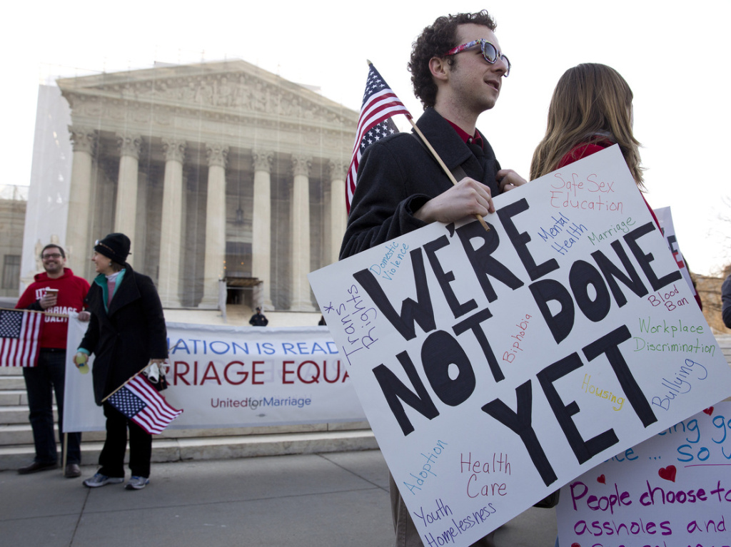 Activists on the steps of the Supreme Court in 2013 when they heard arguments over the Defense of Marriage Act, which denies federal benefits to gay couples legally married under the laws of their state.