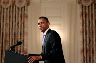 President Barack Obama delivers a brief statement at the State Dining Room of the White House.