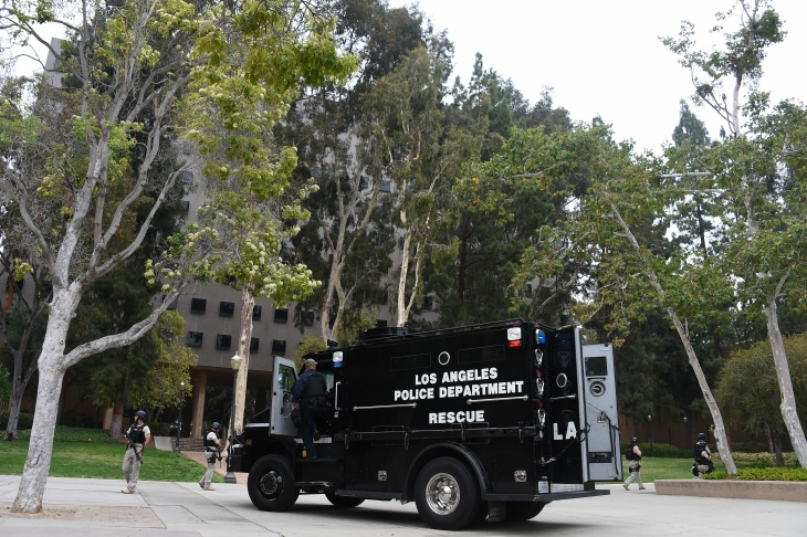 Law enforcement patrol the area on Wednesday, June 1, 2016 following a murder-suicide on the University of California, Los Angeles campus.