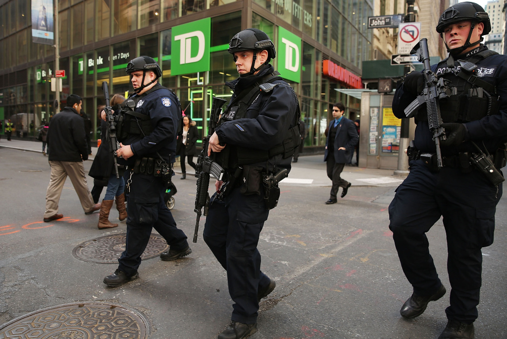 Heavily armed police patrol the streets in lower Manhattan following a heightened terror alert after attacks in the Belgian capital of Brussels on March 22, 2016.