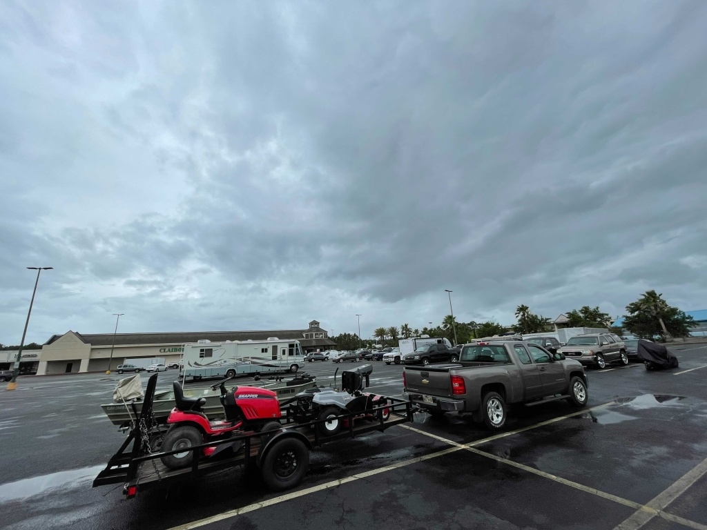 Residents in low-lying areas of Hancock County move their vehicles, lawn mowers, ATVs and boats to higher ground in Waveland, Miss., as a tropical system approaches Friday, June 18, 2021.
