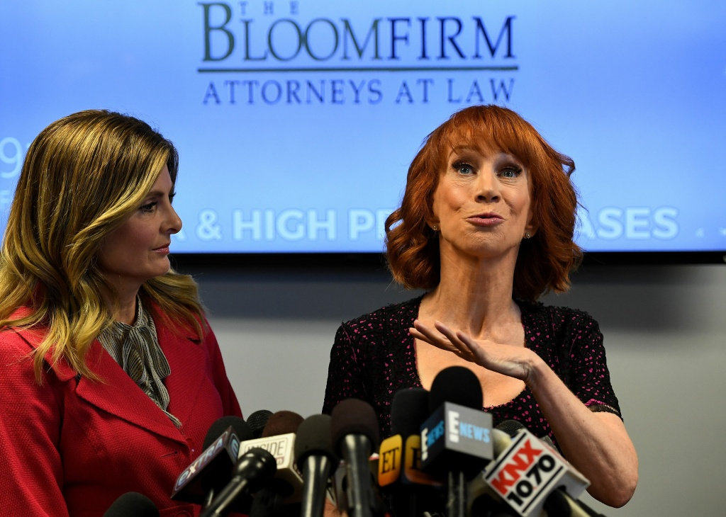 Comedian Kathy Griffin with her attorney, Lisa Bloom, reacts during a news conference about a photo of her holding what appeared to be a prop depicting US President Donald Trump's bloodied, severed head.