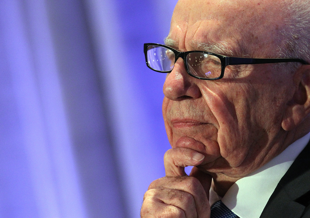 Rupert Murdoch addressed angry employees following the arrest of five senior staff members of British tabloid newspaper