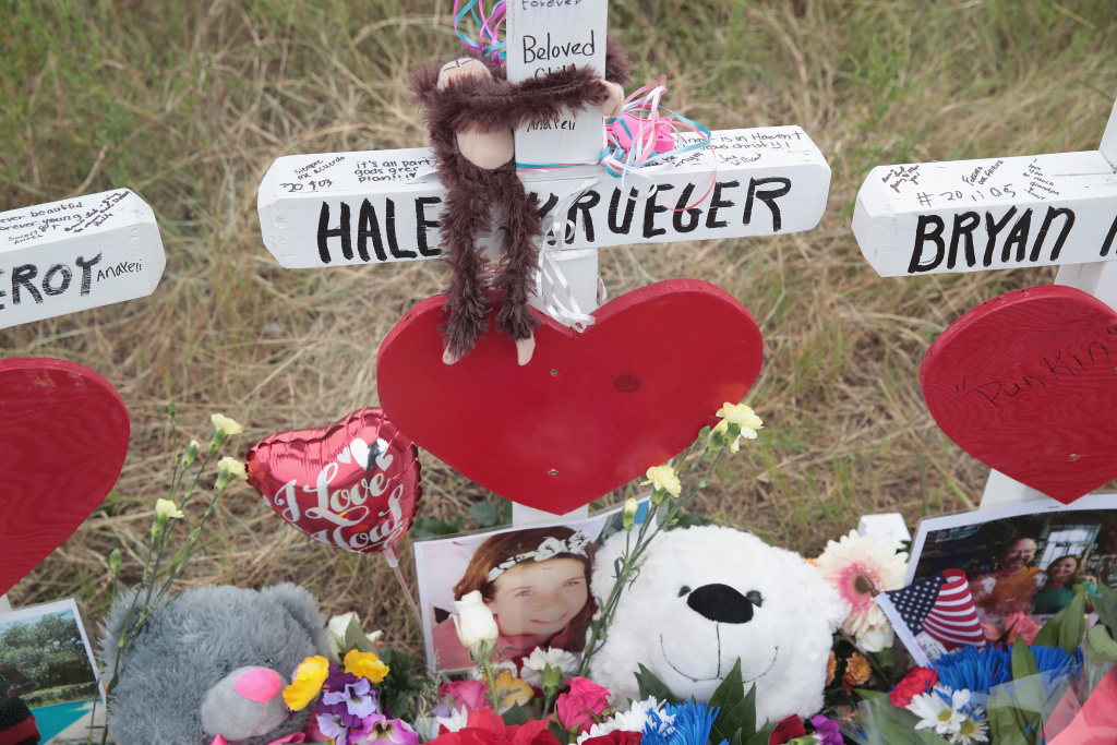 A Teddy bear and a photograph lay at the foot of a cross honoring 16-year-old Haley Krueger at a memorial for the 26 victims killed at the First Baptist Church of Sutherland Springs on November 5, 2017 in Texas.