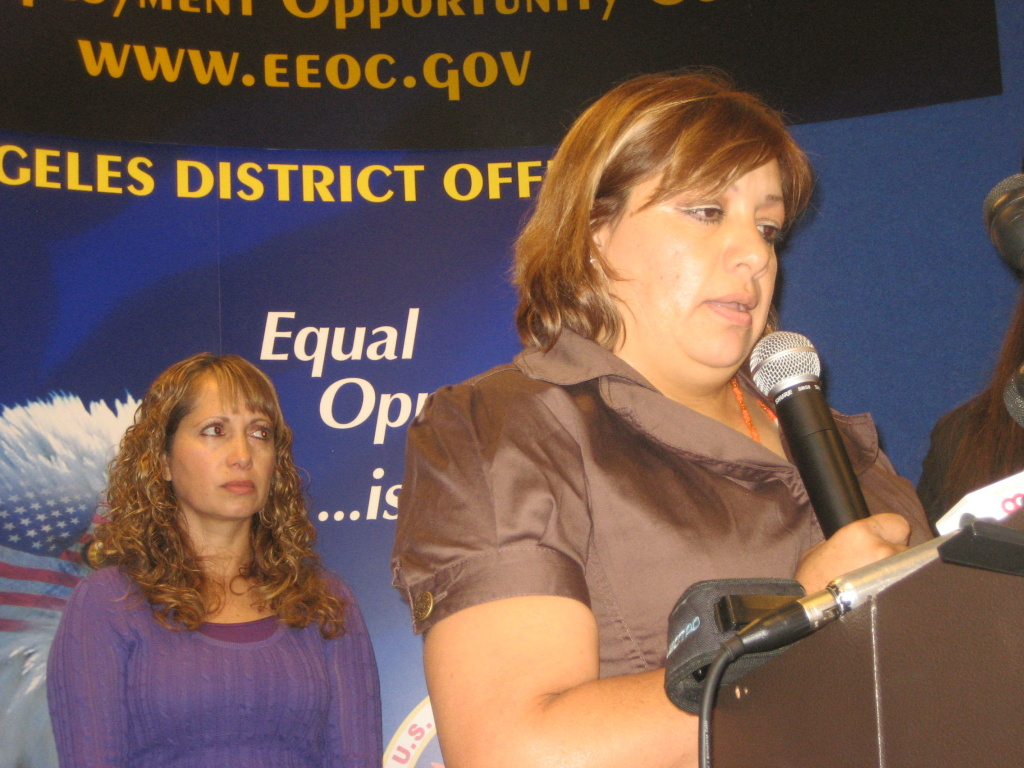 Maria Quintero, in front with microphone, and Teresa Sanchez spoke of incidents of sexual harassment while working as janitors for ABM Industries, Inc., at a Los Angeles press conference, Sep. 2, 2010.