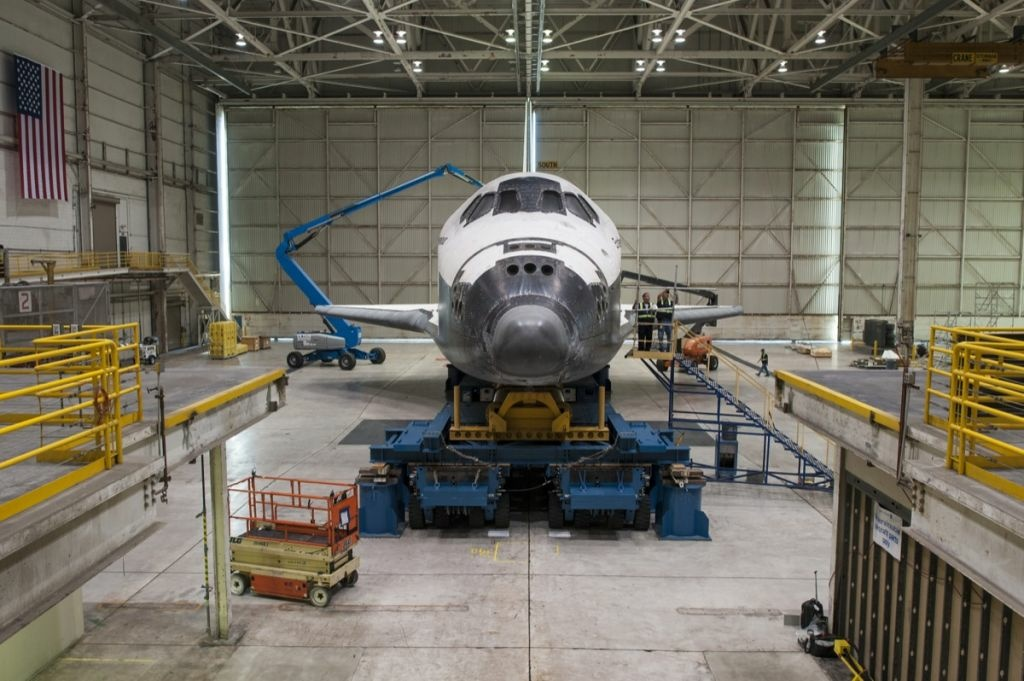 Space shuttle Endeavour atop the Over Land Transporter in a hanger at Los Angeles International Airport, Monday, Sept. 24, 2012.