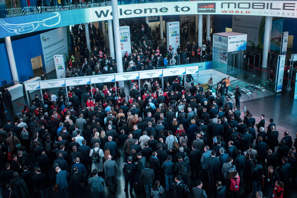 Visitors queue to get access to the venue during the second day of the Mobile World Congress 2014 at the Fira Gran Via complex on February 25, 2014 in Barcelona, Spain. The annual Mobile World Congress hosts some of the world's largest communication companies, with many unveiling their latest phones and gadgets. The show runs from February 24 - February 27.
