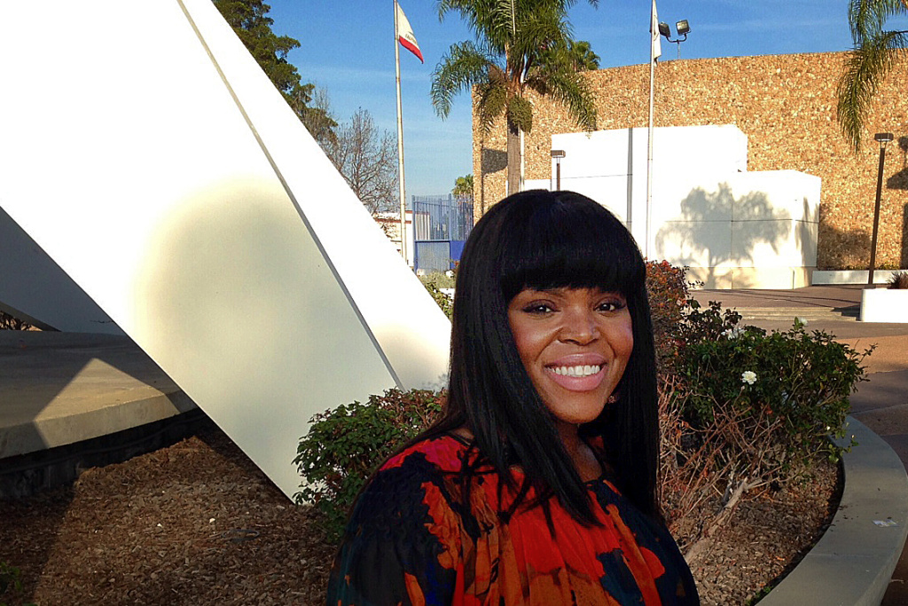 Compton May Aja Brown standing in front of the Martin Luther King Memorial near Compton City Hall.
