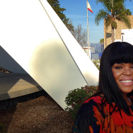 Compton mayor Aja Brown standing in front of the Martin Luther King Memorial near Compton City Hall