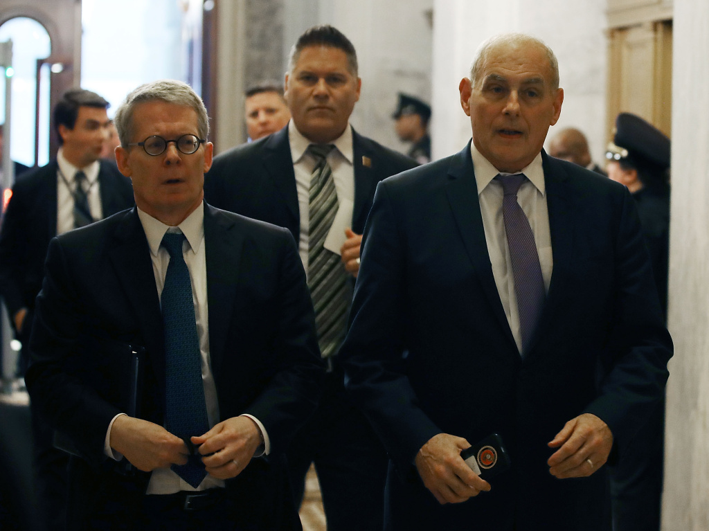 White House Chief of Staff John Kelly (R) and White House lawyer Emmet Flood (L) arrive to attend a briefing at the U.S. Capitol May 24, 2018 in Washington, DC.