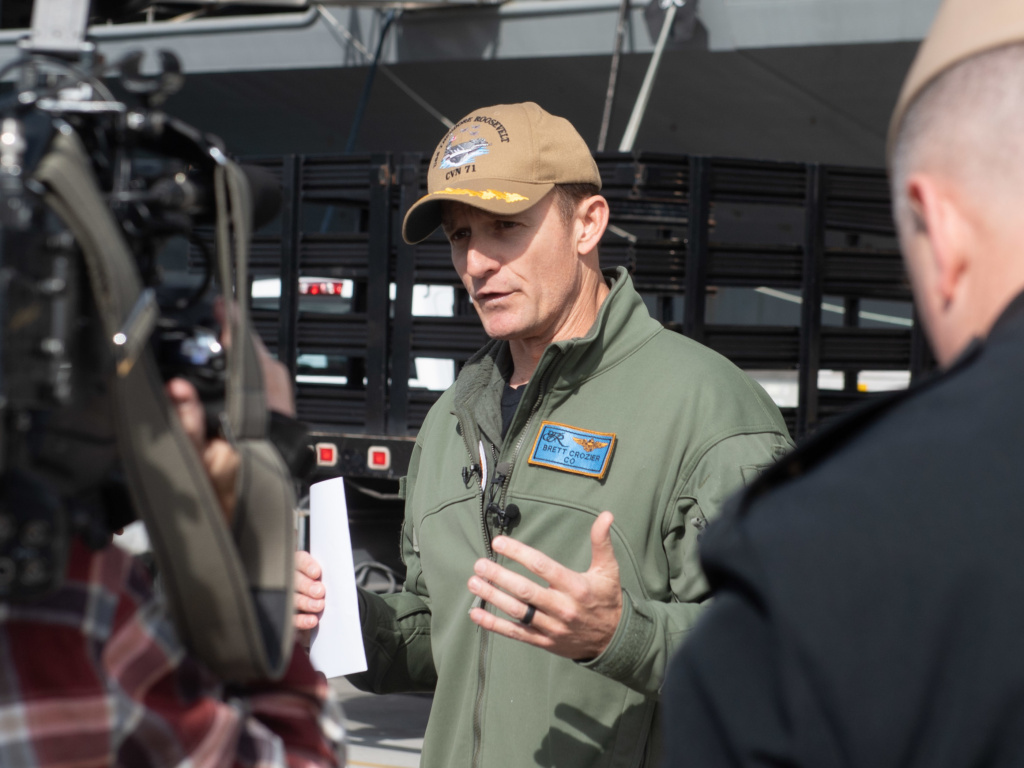 Capt. Brett Crozier, then-commanding officer of the aircraft carrier USS Theodore Roosevelt, talks to reporters in January. The Navy has decided not to restore him to command.