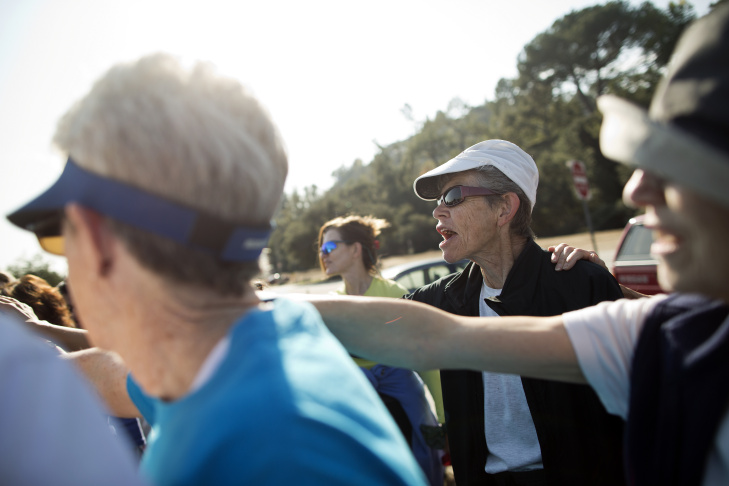 Sarah Ingersoll, right, takes part in a cheer before the first training of the year on Thursday, Jan. 8 at the Rose Bowl. In 2010, Ingersoll started a running group made up of Parkinson's patients and caretakers.